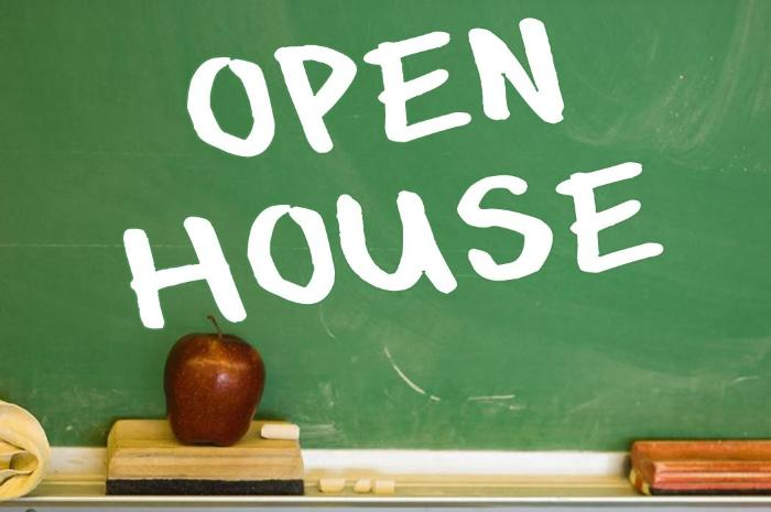 Open House written in white chalk on a green board with a red apple on top of an eraser.